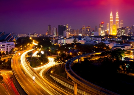 kuala lumpur tower: Stunning light trail scenery at the busy highway in Kuala Lumpur city at night  Stock Photo