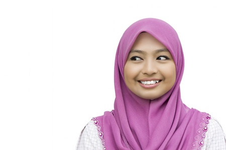 portrait of beautiful young Muslim Woman looking to the copyspace - isolated over a white background  Stock Photo