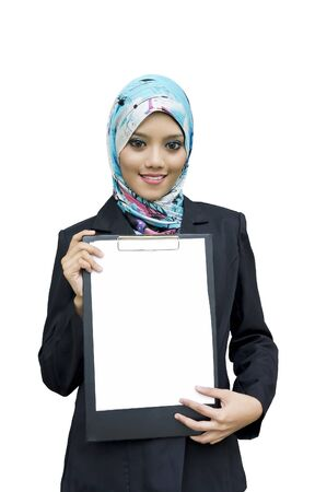 Portrait of a beautiful Muslim woman holding a white paper, isolated on white background photo