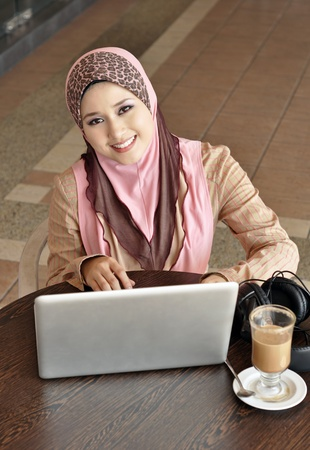 malay ethnicity: Beautiful woman with notebook Stock Photo