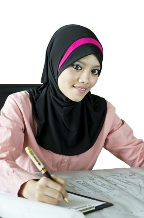 Young architect woman working in office