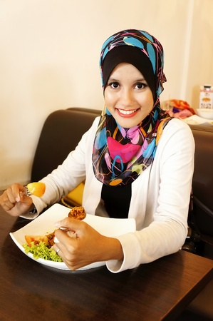 young pretty girl having lunch at a cafe