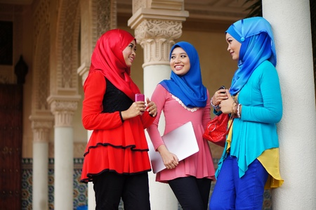 muslimah: Active people  Closeup of group of young three Muslim women talking Outdoors, lifestyle