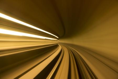 speedy: blur tunnel in orange tone Stock Photo
