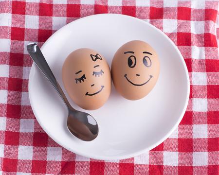 breakfast smiley face: Eggs couple - love concept Stock Photo