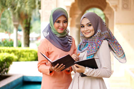 young muslimah woman discussing about their study Stock Photo