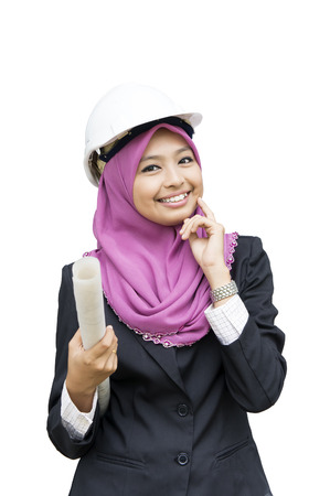 executive helmet: Young Muslim architect-woman wearing a protective helmet