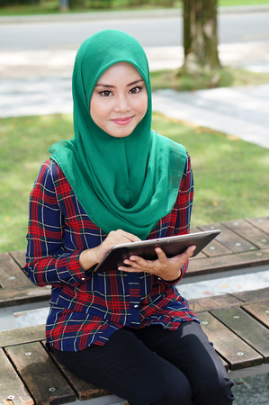 Beautiful young lady with tablet computer photo