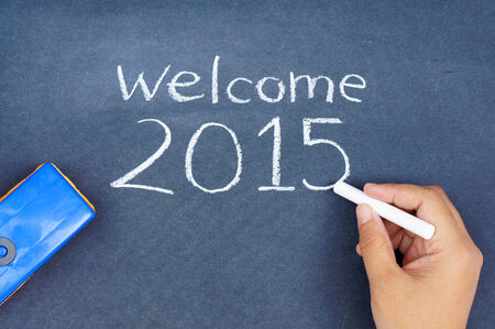 Human hand writing welcome 2015 on chalkboard Stock Photo