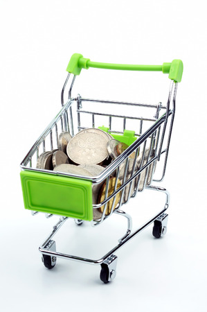 Coin in the shopping cart isolated on white background Stock Photo