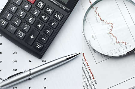 office supplies and graph on the table Stock Photo - 17076169