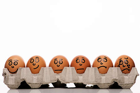 distressing: Pain intensity scale concept with copyspace and eggs characters over white background Stock Photo