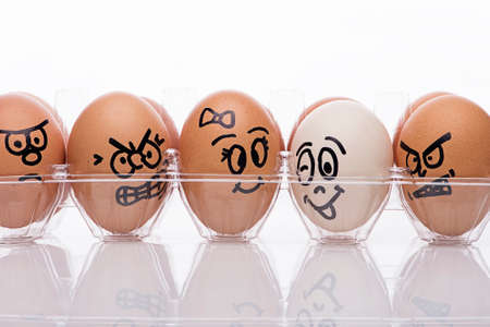 displaying: Egg characters displaying angry emotions towards egg couple Stock Photo