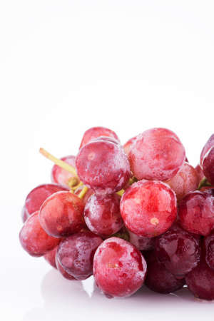bunch up: close up Bunch of red grapes white background.