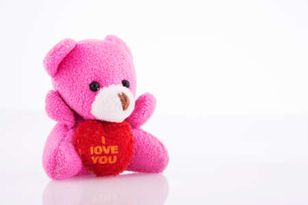 valentine s day teddy bear: Teddy Bear with Heart on white background Stock Photo