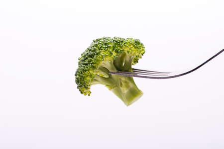 brocolli: Eating Brocolli on Fork Stock Photo