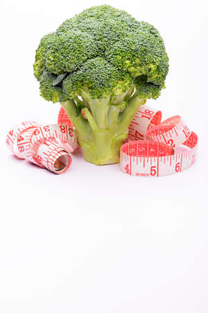 measurement tape: Brocolli and measurement tape on white background