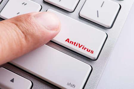 antivirus: Close up Finger on keyboard-Online Conceptual Antivirus Stock Photo