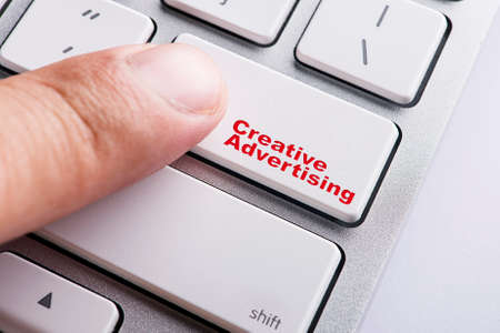 successful campaign: Close up Finger on keyboard-Online Conceptual Creative advertising Stock Photo