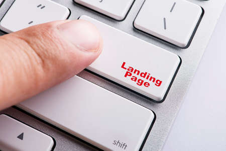 contextual: Close up Finger on keyboard-Online Conceptual Landing Page Stock Photo