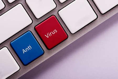 anti virus: Anti virus button on white computer keyboard Stock Photo