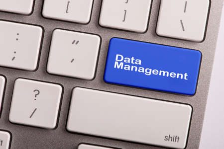 data management: keyboard button with word data management Stock Photo