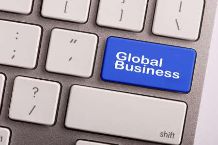teclado: bot�n del teclado con la palabra negocio global Foto de archivo