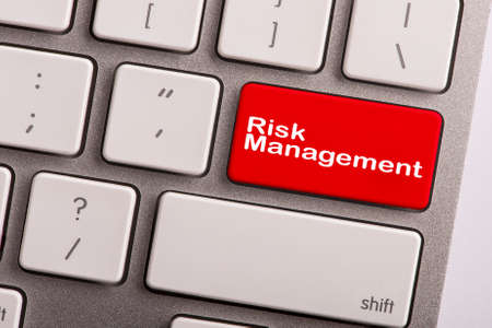 minimization: keyboard button with word risk management Stock Photo