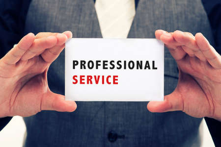warranty questions: Executive Holding card with Message Saying-Professional Service Stock Photo