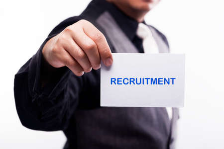 our company: young executive holding card written recruitment