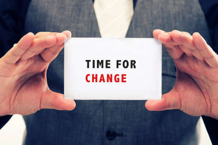 message: Executive Holding card with Message Saying-Time for change