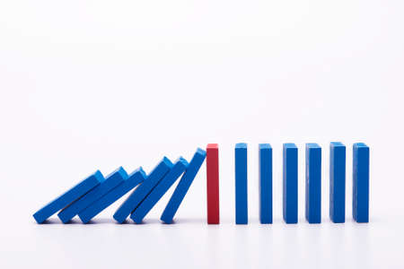Leadership concept colourful dominos over white background