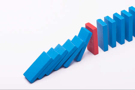 mediate: Leadership concept colourful dominos over white background