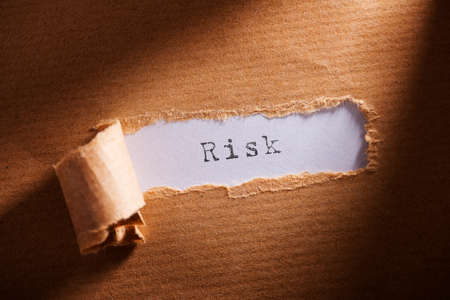 risky situation: ripped paper with word risk Stock Photo