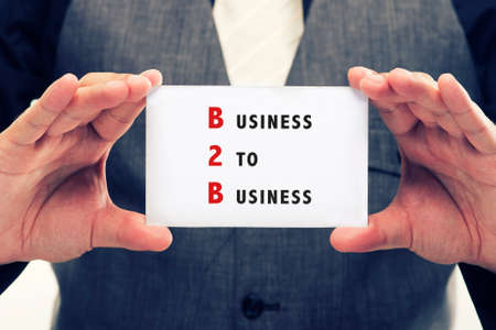 headman: executive with suit showing a signboard with the word B2B written in it