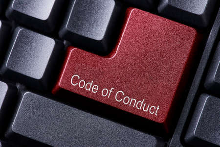 work ethic responsibilities: close up red enter button written code of conduct