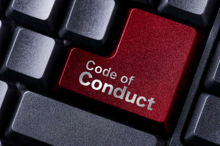 conduct: close up red enter button written code of conduct
