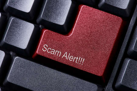 Scam Alert written on keyboard button