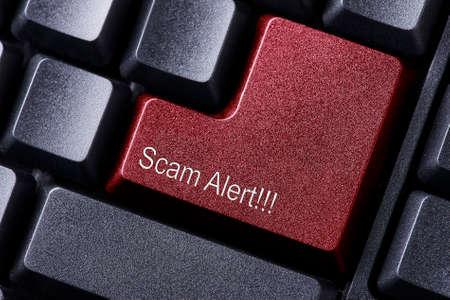 theft prevention: Scam Alert written on keyboard button