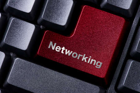 enter button: close up red enter button written networking Stock Photo