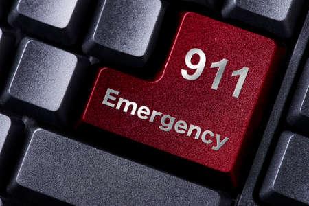 赤に近い入力ボタン書かれた緊急時 写真素材