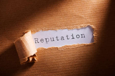 reputation: torn paper with word reputation Stock Photo