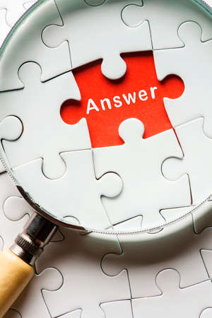 Magnifying glass searching missing puzzle peace ANSWER