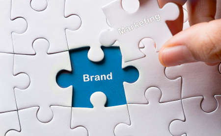 Puzzle with word brand marketing Stock Photo