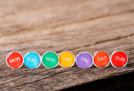 Close up weekly push pins