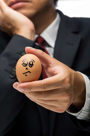 irritate: Emotional Concept-Similar Angry egg character with executive blurred background Stock Photo