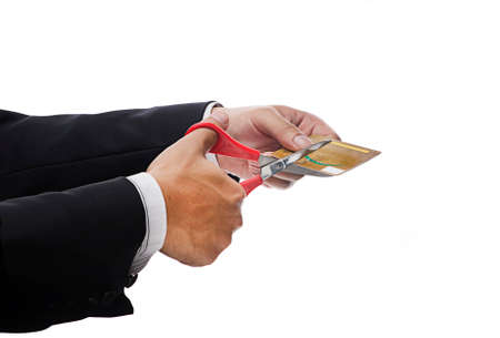 pay cuts: Financial Planning Concept-Executive Hand Cutting credit card over white backgound Stock Photo