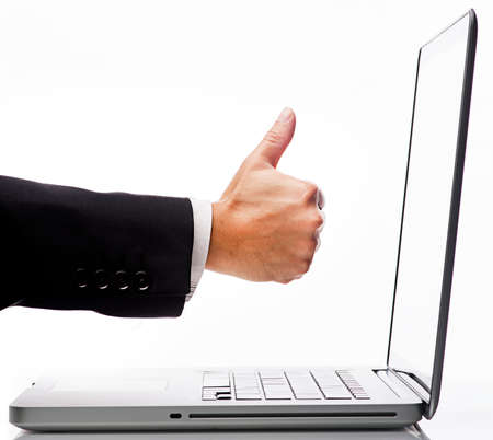 Computer Savvy Concept-Executive Thumb up hand on Laptop Screen Stock Photo