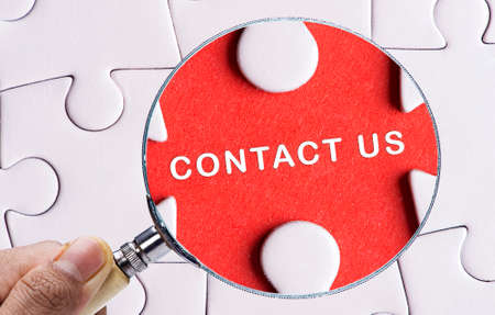 contactus: Magnifying glass searching missing puzzle peace CONTACT US