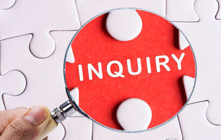 scrutinise: Magnifying glass searching missing puzzle peace INQUIRY Stock Photo